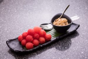Cold watermelon served with dried fish flakes