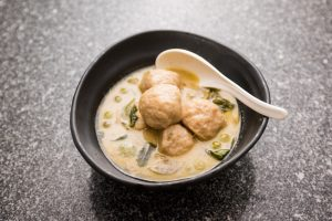 Fish ball stuffed with salted egg yolk in green curry