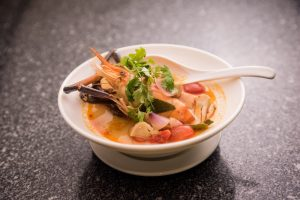 Spicy prawn soup with lemongrass, kaffir lime and straw mushrooms