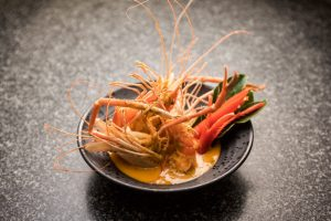 River prawn in red curry with coconut milk